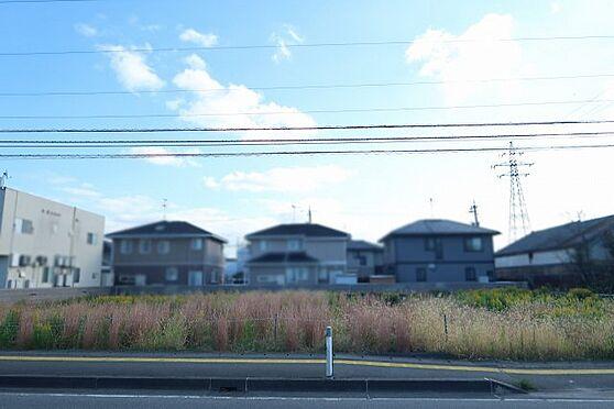 土地-富山市婦中町速星 土地全景(反対車線より撮影)