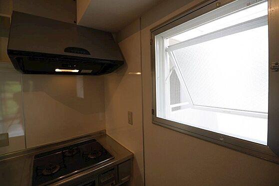 中古マンション-八王子市上柚木3丁目 交換済みのINAX製キッチン。スライドドア採用で使いやすいです。