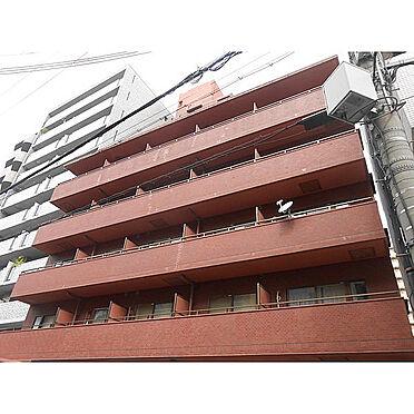 区分マンション-大阪市北区菅栄町 レンガ色の落ち着いた外観